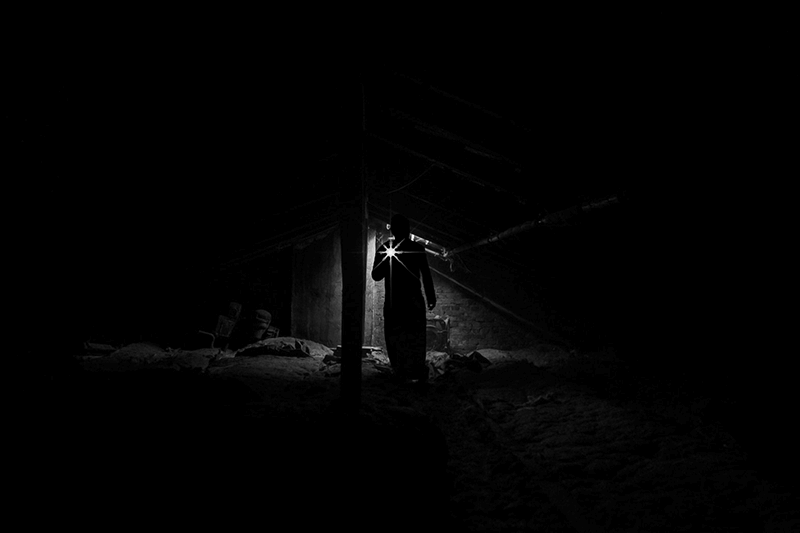 A lone figure in the darkness