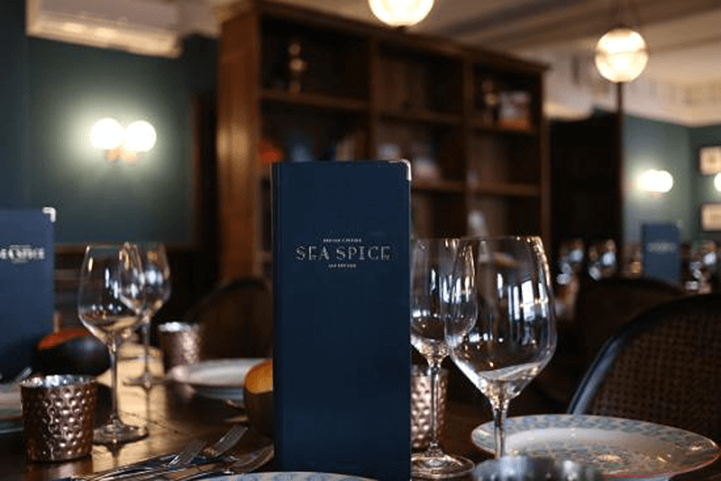 Sea Spice menu and wine glasses