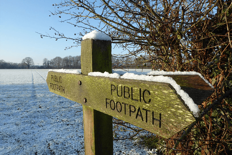 Public footpath sign in the snow at Mollett's Farm