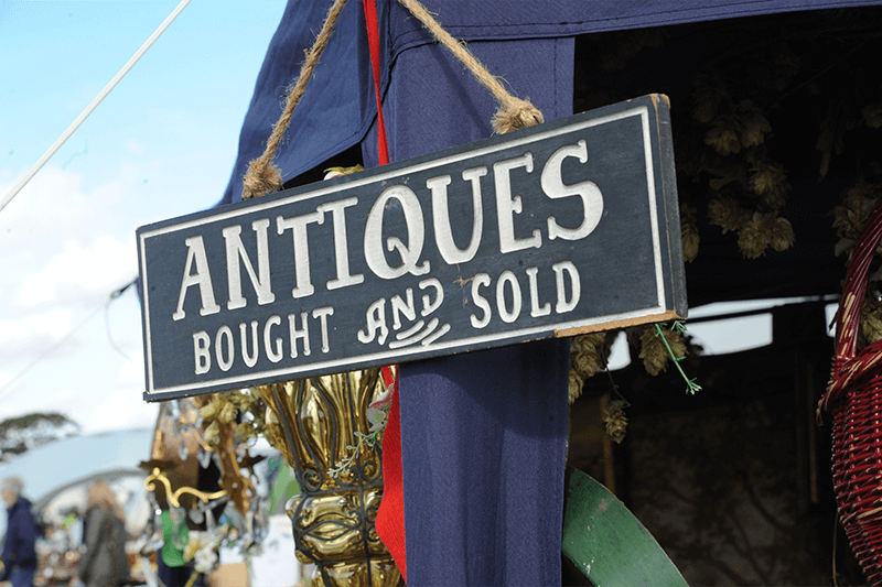 Antiques bought and sold sign