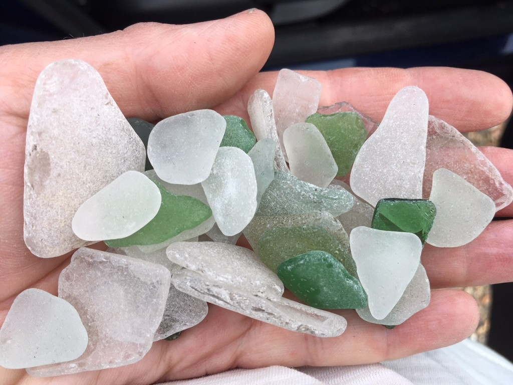 a handful of green and white sea glass
